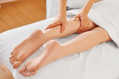 Young Woman Receiving Leg Massage at Spa Center. Body Care Royalty Free Stock Photo
