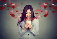 Free Young Woman Receiving Love Sms Text Message On Mobile Phone Royalty Free Stock Photo - 84907585