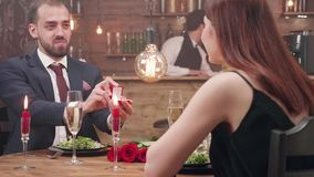 Young woman receiving a marriage proposal at a dinner date. Love and marriage. Couple in love decides to become a family stock video footage