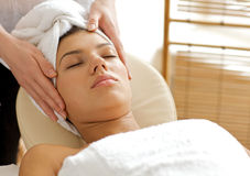 Young woman receiving massage, eyes closed Royalty Free Stock Photo