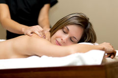Young woman receiving a massage Stock Photos