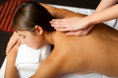 Young woman receiving a massage Royalty Free Stock Photos