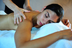 Young woman receiving massage stock images