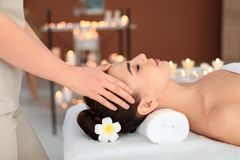 Young woman receiving massage in   salon Stock Photography