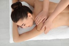 Young woman receiving massage Royalty Free Stock Images