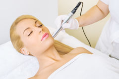 Young woman receiving microdermabrasion treatment stock photo