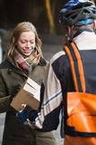 Young Woman Receiving A Package Royalty Free Stock Photography