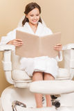 Young woman receiving pedicure in hairdressing salon Stock Image