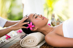 Young woman receiving recreation Balinese massage Stock Images