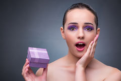 The young woman receiving small giftbox. Young woman receiving small giftbox Royalty Free Stock Image