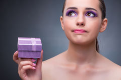 The young woman receiving small giftbox. Young woman receiving small giftbox Royalty Free Stock Photography