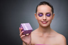 The young woman receiving small giftbox. Young woman receiving small giftbox Royalty Free Stock Photos