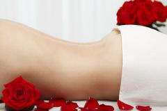 Young Woman Receiving Swedish Deep Tissue Massage Red Roses stock photography
