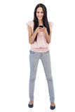Young woman receiving text message Royalty Free Stock Images
