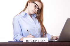 Young woman receptionist. Working Royalty Free Stock Image