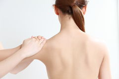 Young woman receves chiropractic Stock Photography
