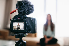Young woman recording daily video blog on camera mounted on trip Stock Image