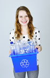 Young woman with recycling box Stock Photo