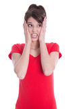 Young woman in red is anxious. Royalty Free Stock Images