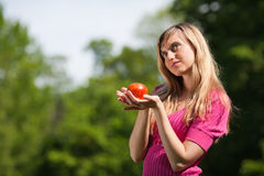 Young woman with a red apple Royalty Free Stock Photography