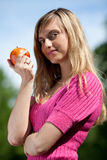 Young woman with a red apple Royalty Free Stock Photo