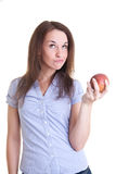 Young woman with a red apple Royalty Free Stock Photos