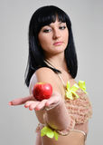 Young woman with a red apple. Stock Image