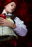 Young woman with red apple. In a poetic representation Royalty Free Stock Photos