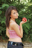 Young woman with red apple Stock Photography