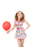 Young woman with red balloon isolated Stock Photography