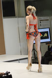 Young woman in a red bathing suit Fashion show  Lingrie Expo Moscow Stock Photo