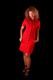 Young woman in red on black Royalty Free Stock Photos