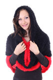 Young woman in red and black poncho Stock Image