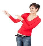 Young woman in red blouse pointing Stock Photos