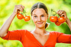 Young woman in red blouse with tomato Stock Image