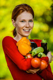 Young woman in red blouse with vegetable Stock Photo