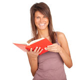 Young woman with red book Stock Photography