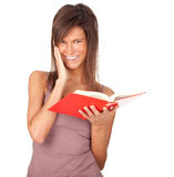 Young woman with red book Royalty Free Stock Images