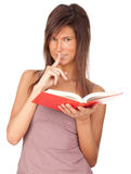 Young woman with red book keeping silence Royalty Free Stock Photos