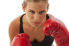 Young woman with red boxing gloves. Young woman wearing red boxing gloves Stock Images