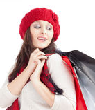 Young Woman in Red Cap with Shopping Bags Royalty Free Stock Images