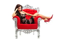 Young woman in a red chair. Retro style. Stock Photo