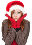 Young woman in red Christmas hat Royalty Free Stock Photo