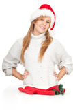 Young woman in red Christmas hat Stock Images