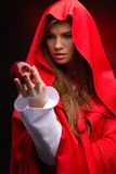 Young woman with red cloak holding apple in her hand Stock Images