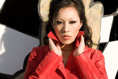Young woman in the red coat Royalty Free Stock Images