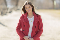 Young woman in red coat Royalty Free Stock Photo