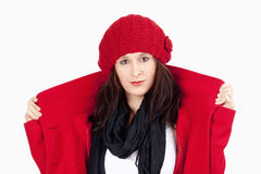 Young Woman in Red Coat and Cap Stock Photos