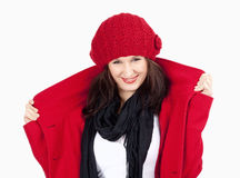 Young Woman in Red Coat and Cap Smiling Royalty Free Stock Photos