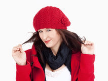 Young Woman in Red Coat and Cap Smiling Stock Images